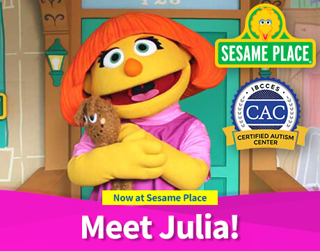 Julia hugs her toy, Fluffter, and smiles | Now at Sesame Place Meet Julia! | Certified Autism Center