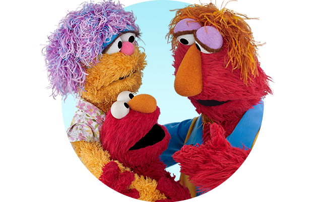Elmo and his parents hug and smile together
